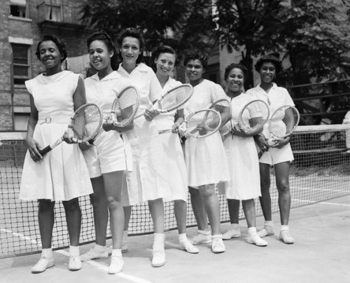 Tennis players at the New York State Negro Tennis Championships, at the Cosmopolitan Tennis Club in New York City, August 1940.   From left to right: Louise Graham, Mt. Vernon, NY; Katheryn Neal,  Columbia, SC; Katheryn Watson, Columbia, SC; Vivian Russell, Columbia,  SC; Myrtle Beavers, New York City; Beryl Lyroke, Boston MA and Lamarr  Turpi, Poughkeepsie, NY. Photo by Bettman/Corbis