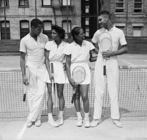 Four Black Tennis stars at the New York State Negro tennis championships, August 15, 1940. From left to right (the Corbis caption only names three): Jimmie McDaniels of Xavier U. and Los Angeles, CA (National Men's singles and doubles champ). Flora Lomax and  Detroit's Public Parks Women's doubles champ. Richard Cohen of Xavier  U. and Denver CO., (partner of Jimmie McDaniels in Doubles and National  men's doubles champion).