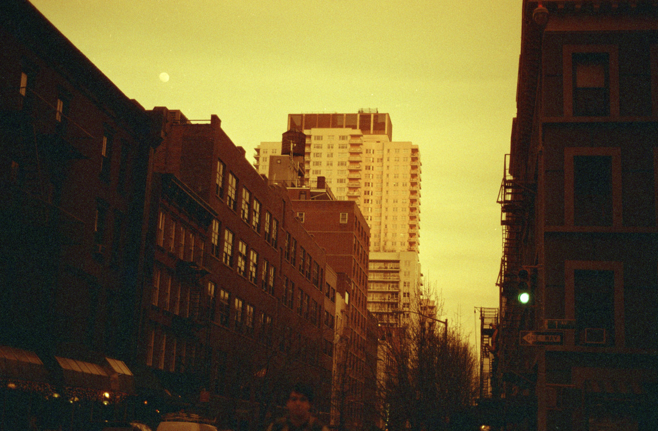 zach on 1st and 76th, shot with redscale lomo film