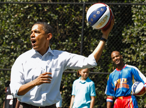"PHOTO OF THE DAY: President Obama shoots a basketball while participating in a ""Let's  Move"" clinic with members of the NBA, WNBA and the Harlem Globetrotters  during the White House Easter Egg Roll on the South Lawn of the White  House on Monday. (Chip Somodevilla/Getty Images)"