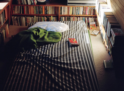 THIS. My ideal bedroom. To be surrounded by books with sunlight peeking in. I just need to change the bedsheet and put more pillows. :) devonisonfire:  — by craig.spence on Flickr.