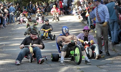 "Adults on Big Wheels Race Down San Francisco Streets  When you just can't wait the rest of the year for Bay to Breakers… San Francisco Chronicle:  It was a most solemn and sacred day, and for some in San Francisco that meant one thing - time to don a bunny suit and race down Potrero Hill on a Big Wheel. ""It's total chaos - everyone's screaming and laughing, people are spinning out, going down backward,"" said Alon Zaslavsky, a movie animator from San Francisco, just after he tried the course for the first time Sunday afternoon. ""It's great. The whole point is to crash."" The 11th annual Bring Your Own Big Wheel derby attracted more than 2,000 celebrants to one of the steepest, curviest streets in San Francisco: Vermont between 20th and 22nd. Anyone with a plastic, three-wheeled kids' vehicle was welcome to participate. The event was free, but racers had to sign a waiver before careening down the hill - a 14.3 percent grade, according to one tourist guide - with no brakes, helmets or elbow pads. The waiver's nod toward potential litigation did not dampen the party. The street was a jubilant mix of beer, music, dogs, tamales, kids, friends and, of course, costumes. There were prom queens, Evel Knievels, Easy Riders, Dorothys, Carmen Mirandas and church ladies.       via abcworldnews:"