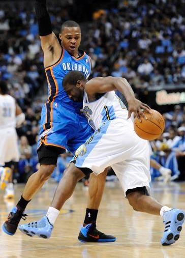 Denver Nuggets guard Raymond Felton (20) is fouled by Oklahoma City Thunder guard Russell Westbrook (0) during the first half in game 4 of a first-round NBA basketball playoff series Monday, April 25, 2011, in Denver.