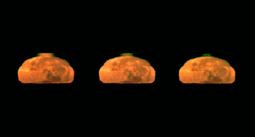 Rare Moon Green Flash Captured  On Cerro Paranal, the 2600-metre-high mountain in Chile's Atacama  Desert that is home to ESO's Very Large Telescope, the atmospheric  conditions are so exceptional that fleeting events such as the green  flash of the setting Sun are seen relatively frequently. Now, however, ESO Photo Ambassador Gerhard Hüdepohl has captured an even rarer sight: a green flash from  the Moon, instead of the Sun. The photographs are very probably the best  ever taken of the Moon's green flash. Gerhard was surprised and delighted to catch the stunning green flash  in this series of photographs of the setting full Moon crossing the  horizon, taken on a clear early morning from the Paranal Residencia. The Earth's atmosphere bends, or refracts, light — rather like a  giant prism. The effect is greater in the lower denser layers of the  atmosphere, so rays of light from the Sun or Moon are curved slightly  downwards. Shorter wavelengths of light are bent more than longer  wavelengths, so that the green light from the Sun or Moon appears to be  coming from a slightly higher position than the orange and red light,  from the point of view of an observer. When the conditions are just  right, with an additional mirage effect due to the temperature gradient  in the atmosphere, the elusive green flash is briefly visible at the  upper edge of the solar or lunar disc when it is close to the horizon. […] (via ESO)