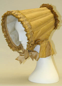 omgthatdress:  Bonnet ca. 1804-1815 via The Costume Institute of the Metropolitan Museum of Art  It looks like a lampshade, but I kind of want one.