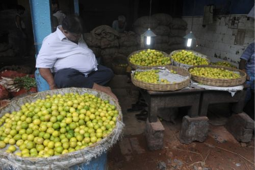 All Puckered Out? A lime vendor takes a nap at a wholesale market in Kolkata, India, on July 29, 2010. DESHAKALYAN CHOWDHURY/AFP/Getty Images (via Foreign Policy)