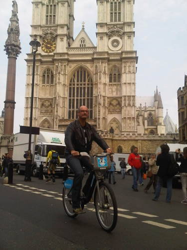 sunriseon7:  Kochie is riding his way around London. It's a great way to get around - and avoid the masses of screaming girls chasing after him.