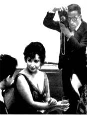 Sammy Davis Jr. snapping a picture of Elizabeth Taylor and Eddie Fisher. Photo by Arthur Silber, Jr.