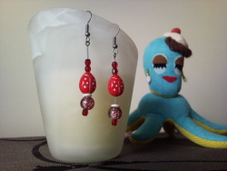 Ladybird, ladybird! These earrings are made with a mixture of glass and acrylic beads on antique look silver hooks.