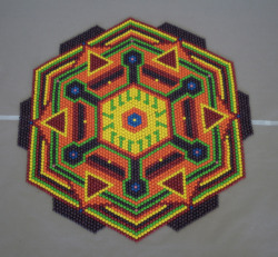 teethirtythree:  Bonus! In college I made a mandala out of Skittles! I'm still pretty proud of it and thought I would share. Edit: In response to some questions, this piece was around 5 feet in diamater and took about 15 pounds of skittles. I wish I had a good reference for size in the pic. Oh it smelled really good too.  OM NOM NOM! I mean, oops, noooooo, I didn't eat your mandala… :/ ;)