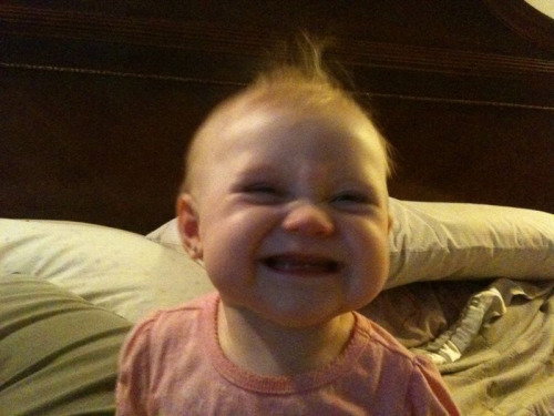 Adelaide has two teeth and is the most adorable baby you've ever seen. This is her new smile, and it kills me every time.