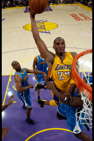 "Pictured is Kobe Bryant, soaring on a gimpy left ankle, about to make a monster dunk over the Hornet's center Emeka Okafor in last night's Game 5 win against New Orleans in the first round of the Western Conference playoffs. This thunderous dunk was the signature moment of the game and may have what turned the tide completely towards the Los Angeles Lakers. The dunk also reminded fans of a few years back when a younger Kobe used to elevate as high and throwdown malicious dunks routinely, seemingly effortlessly. I think it surprised no one that Kobe, hobbled by a strained ankle which occurred in the waning moments of Game 4 loss to the New Orleans Hornets, would not only play in last night's game but somehow be able to persevere through the pain and step up his game and intensity level. Because he liked to mimic his moves and mannerism, Kobe has always been compared to his idol Michael Jordan. His tremendous physical abilities and tenacity has allowed him to seamlessly execute any move Michael made and sustain the energy level and focus that was so consistent with Jordan's game throughout his entire career. Kobe's footwork and explosiveness could also match that of Michael's. They are virtually the same height and nearly weighed the same. Both have won multiple championships playing under coach Phil Jackson. The comparisons are inevitable. I never thought I'd ever see as great a player as Michael Jordan. I still haven't. Sure, Bryant could emulate Jordan in so many aspects of his game but even Jackson was quoted as saying that ""it's one thing to hope to be like [Mike], but it's another thing to be like him."" Kobe Bryant may not ever be Michael Jordan. However, it's his ability to accelerate his game, that killer instinct and the indomitable will to pl"