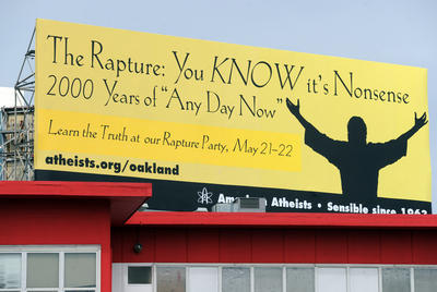 "The Rapture: You KNOW it's nonsense      2000 Years of ""Any Day Now"" Prompted by an evangelical group from Oakland that has been putting up signs declaring Judgement Day is coming May 21, an atheist group has put up this competing billboard in San Francisco, Calif. On Friday April 22, 2011, northbound travelers approaching the Bay Bridge were greeted by the billboard above a T.J. Maxx store. (Karl Mondon/Staff)"
