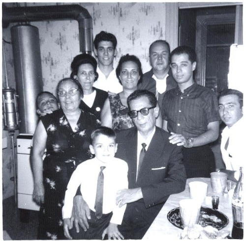 Just found this photo from the 1960s of my dad's side of the family, taken in their apartment on Cottage Street in East Boston. My grandmother Carmella is smack-dab in the middle and my grandfather Peter is behind her to the right. Cute.