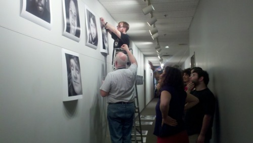 Hanging our 'Faces as Landscapes' piece at Pittsburgh Filmmakers. Can you spot my face?