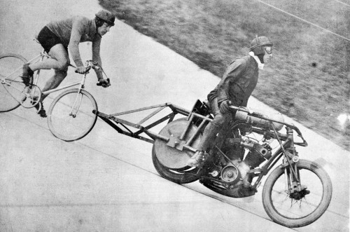 PEEP THAT CRANKSET   « Harry Grant… at his first successful attempt on the motor-paced hour record at the Parc des Princes, Paris, July 1932 and paced by Leon Vanderstufyt on a massive pacing machine with a roller 60cm behind the rear wheel.  He broke the world records for 5km, 10km and 50km going on to set a new distance for the hour record of 52 miles 215 yards riding a Selbach taper tube pacing machine. »  More info on Bikeville.