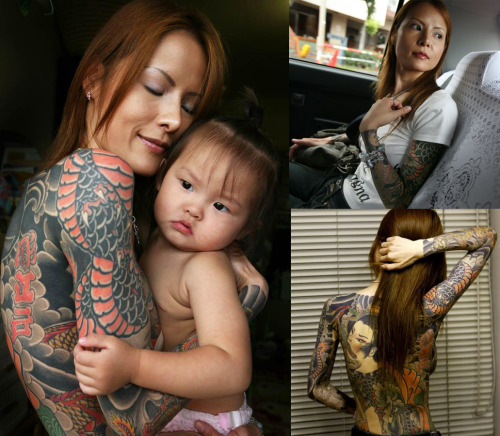 xsupervillain:   Shoko Tendo, daughter of a yakuza boss, depicts her chaotic life of drug-addiction, miscarriage, deaths, poverty and psychological & sexual abuse through her heart-breaking memoir. She is known as the first Japanese female ever to break the code of silence and speak about life for women in the underworld.  She wrote a book called Yakuza Moon: Memoirs of a Gangster's Daughter. The tattoo artist that inked her said that she took it like a real Yakuza. She showed no signs of pain. Ya'll should read the book. It's amazing.