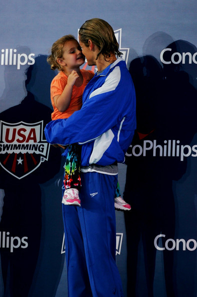 Dara Torres holds her daughter, Tessa, on the medal stand after winning the women's 50 meter freestyle final on Day Three of the 2009 ConocoPhillips Nationals Championships & World Championship Trials on July 9, 2009 at the Indiana University Natatorium in Indianapolis, Indiana. (via 2009 ConocoPhillips Nationals Championships & World Championship Trial Day 3 - Zimbio)