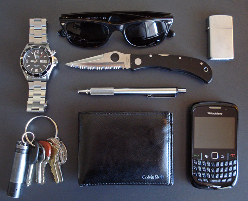 everydaycarry:  submitted by Josh  I've been enjoying the site for a few months now. Here's my carry today. -Ray Ban New Wayfarers -Spyderco C34-Zebra F-701 Pen-Leather Wallet-Matte silver Zippo-BlackBerry Curve-Orient Mako Watch-Keys with old Coast LED light Pretty happy with everything, but will probably replace the light with a single AAA Fenix or Maratac soon. What would your pick be for an economical single AAA light? Thanks, and keep up the good work!  Editor's Note: Great EDC. Slim, functional, and pretty stylish. The Jess Horn looks like a great knife, it's interesting to see someone EDC a fully serrated blade though. As for your keychain light, you can look into the E05 like you said or the Maratac AAA. A similar light in that pricerange is the iTP EOS A3. Albeit at a higher pricepoint, the DQG II is another option for a very compact light with good tech behind it AFAIK. Good luck and thanks for sharing!
