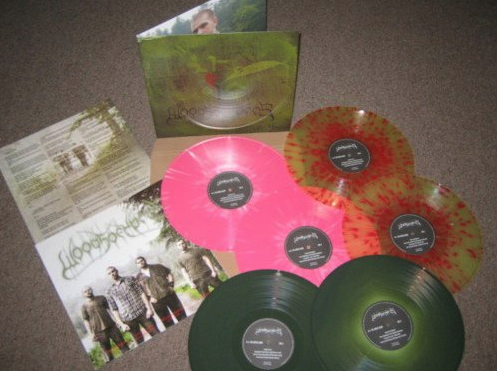 "WOODS OF YPRES is on wax- choose from Pink/White ""Shards"",  Hemorrhage/Piss ""Pain"" or plain o'l Green, its up to you. earache.com/store"
