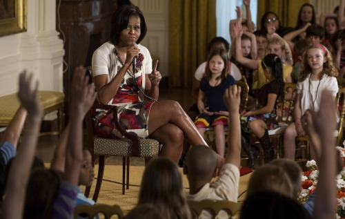 PHOTO OF THE DAY: First Lady Michelle Obama answers questions from children of White  House and Executive Office employees in the East Room of the White  House on Thursday, during the White House's annual Take Our Daughters  and Sons to Work Day. (SAUL LOEB/AFP/Getty Images)