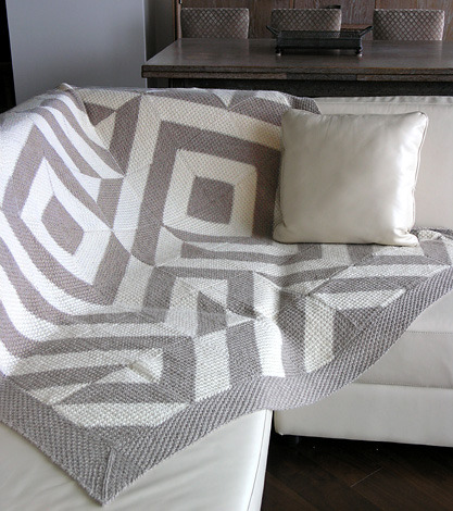 You know, I actually like this throw design by Shui Kuen Kozinski.  And the knitting pattern is free, to boot (just need to sign-in to the elann.com website).  But be forewarned: with 49 individually knit bi-colour blocks plus border pieces, you will be weaving in yarn tails 'til the end of time.