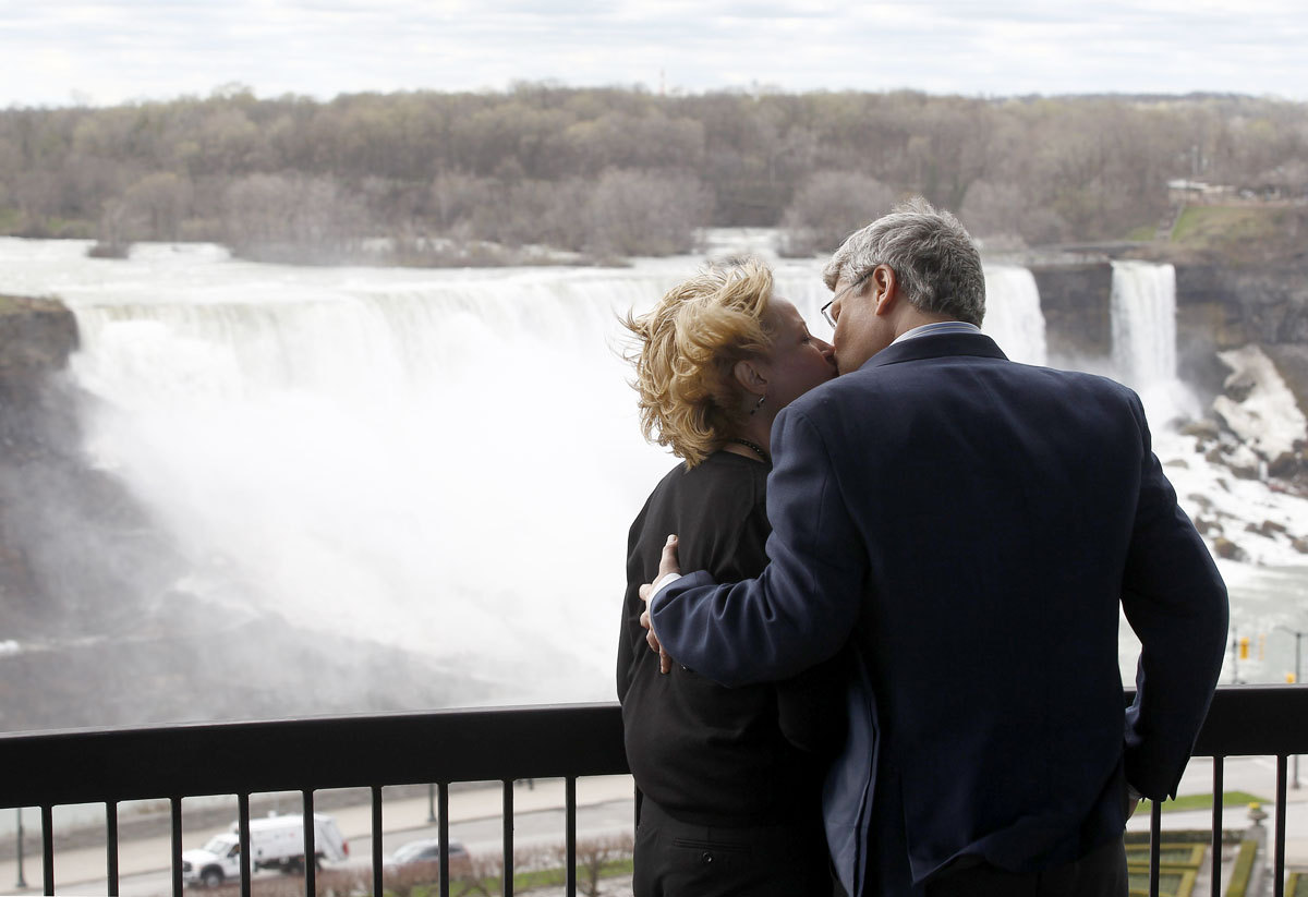"After kissing his wife at Niagara Falls (above), Stephen Harper talked to the Post's John Ivison saying that ""world would be astounded"" if the NDP won the election. Photo by Chris Wattie/Reuters"