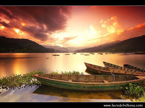 njoi:  Nepal - Sunset at Pokhara's Lake Phewa (by © Lucie's Photography) Pokhara is situated in the northwestern corner of the Pokhara Valley, which is a widening of the Seti Gandaki valle.The Pokhara Valley is one of the most picturesque spots of Nepal. The  beauty of the valley is enhanced by its lakes Phewa, Begnas and Rupa  which have their source in the glacial region of the Annapurna range of  the Himalayas. Pokhara is situated 200 km west of Katmandu at an  altitude of 900 meter only from the sea level.