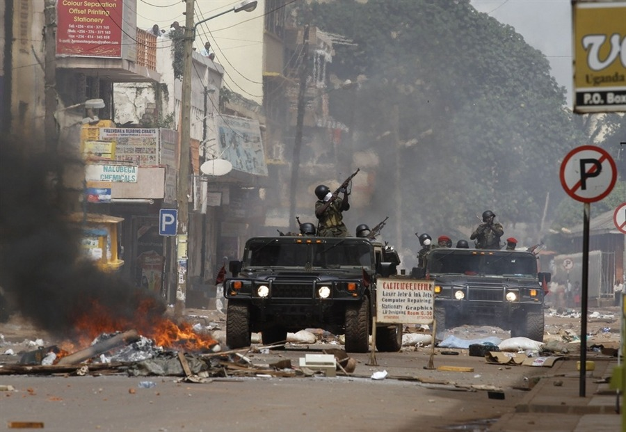 newsflick:  Ugandan soldiers shoot at demonstrators, who pelt them with rocks from apartment buildings, during riots in Kampala on April 29. (Marc Hofer)  Ugandan army troops and police faced off against rioting demonstrators in downtown Kampala on Friday, the first time the Uganda's growing protest movement had reached the country's capital. Red Cross officials said at least one person was killed and 64 wounded. Source   The recent bout of unrest began after the brutal arrest of the Ugandan opposition leader was caught on video.