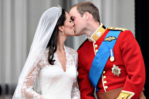 Prince William and his wife Kate, Duchess of Cambridge kiss on the balcony in    Buckingham Palace after their wedding (AP)