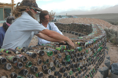 Earthship article on Etsy. Home build from recycled materials that use their water four times.