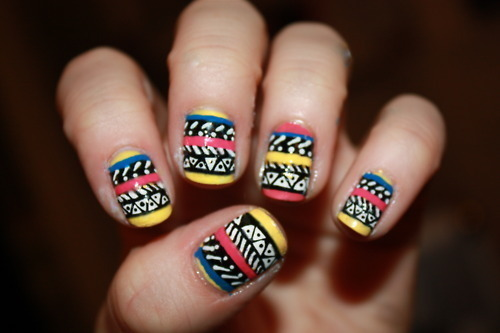 twistinginthewater:  some of the most badass nails ever.