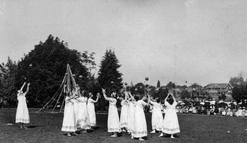 Greek maidens playing ball in the Oregon State University May Day Pageant, 1920s