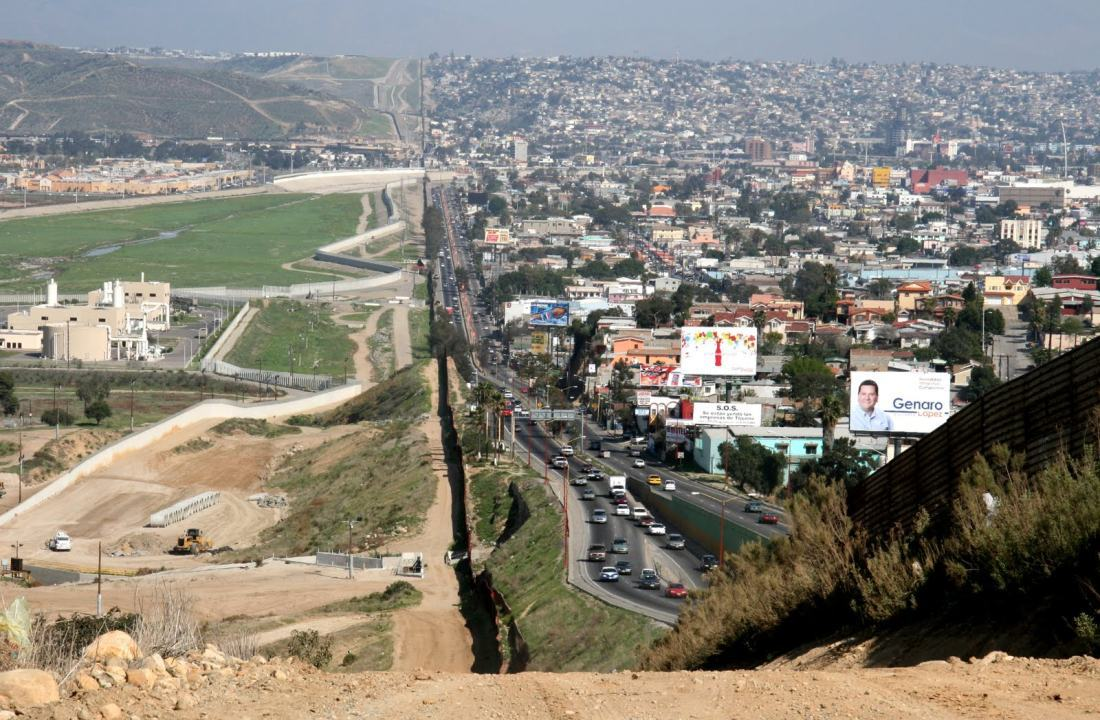 A small fence separates densely populated Tijuana, Mexico, right, from the United States in the Border Patrol's San Diego Sector. Construction is underway to extend a secondary fence over the top of this hill and eventually to the Pacific Ocean. See anything odd about this picture?