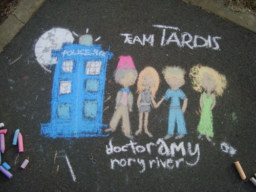 rainbowsockgirl:  just drew this out on the back lane :) Team Tardis [sorry, limited colours and poo, i tried to make river's dress look like her one out of Day Of The Moon…]