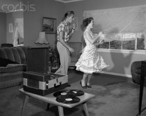 Couple Dancing at Home to their Record Player