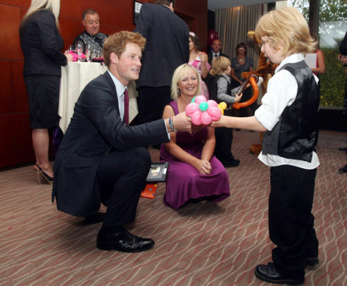 fyprinceharry: Prince Harry meets Harrison Holmes at the WellChild Awards on September 28, 2009 in London, England