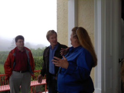 Annie Haven, Steve Bender and P.Allen Smith on the front porch of the home at Moss Mountain Farm.