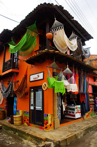 stonefreedreamer:  pasionporcolombia:  esquina colombiana 2 (by DIWX10)  um… can i please have one of these beautiful hammocks?