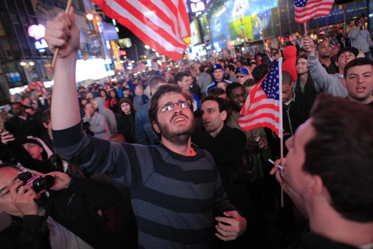 People react to the death  of Osama bin Laden in Times Square in New York early May 2, 2011. Eric  Thayer/Reuters
