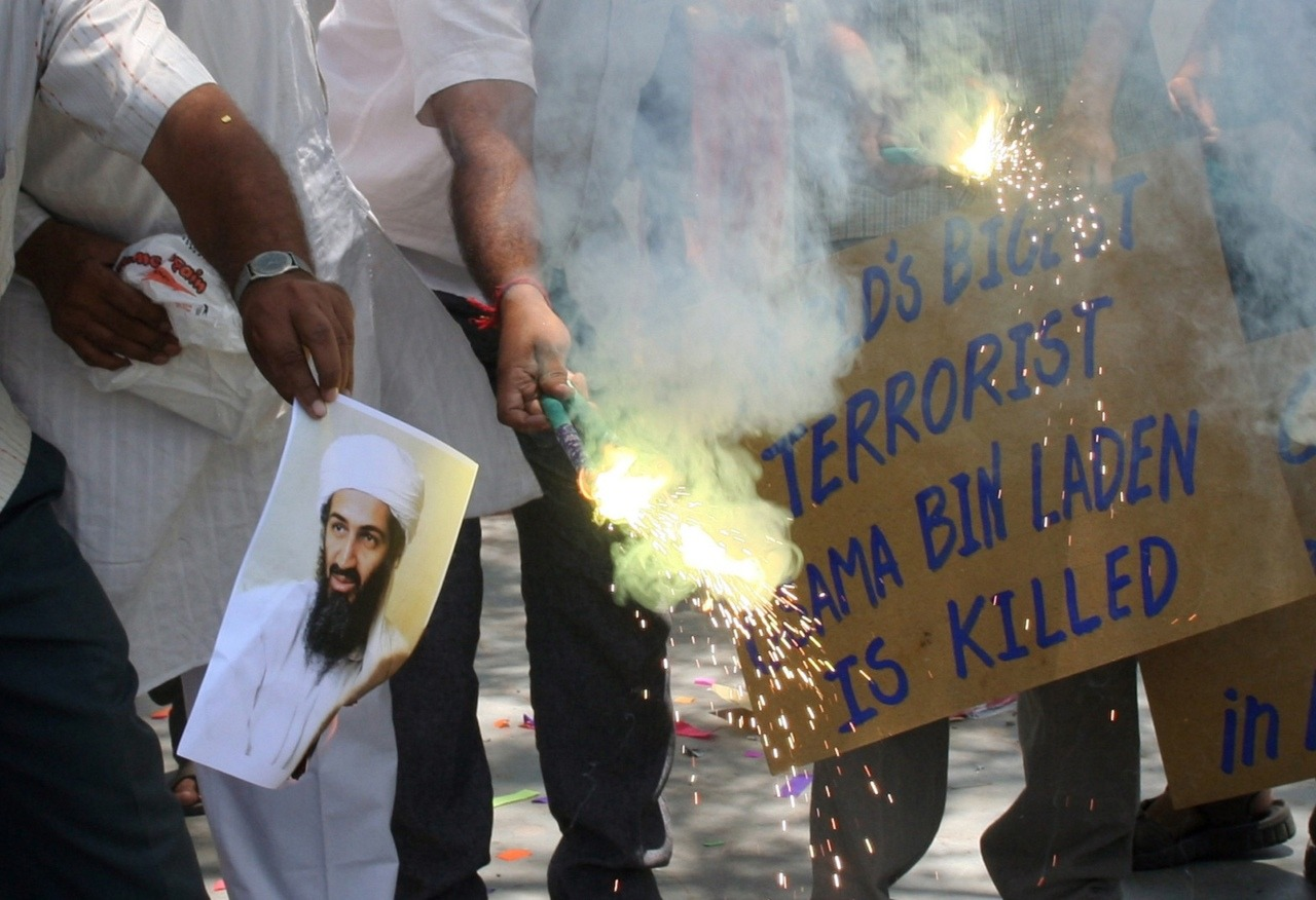 People burn a photograph of al Qaeda leader Osama bin Laden as they celebrate his death, in the western Indian city of Ahmedabad May 2, 2011. (Reuters)  Mixed reaction in Arab world over bin Laden death Video: Barack Obama's statement on bin Laden's death The death of bin Laden: Who knew and what does it mean? Assignment Kandahar: After bin Laden Osama bin Laden: Timeline of Terror