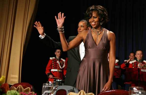 US President Barack Obama and first lady Michelle Obama arrive on stage at the annual White House Correspondent's Association Gala at the Washington Hilton hotel April 30, 2011 in Washington, DC. She looks amazing!