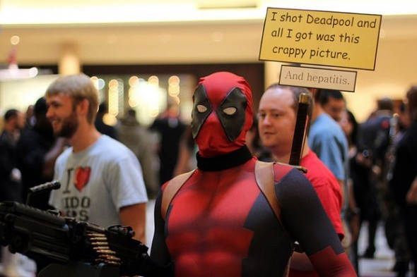Deadpool Cosplay photo by Brian Work From Dragon Con 2010. The fact that someone even got Deadpool's yellow thought bubbles incorporated into the costume is total dedication and mastery of your craft. Kudos all around.  (via: fashionablygeek)