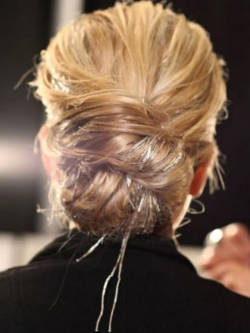 bride2be:  i love the idea of weaving some tinsel into your updo… this hair style has the right kind of sass!