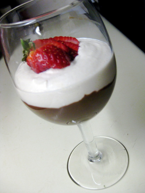 "Raw Chocolate Mousse topped with Raw Vanilla Creme served with strawberries for dipping.  I made this delicious dessert last night, and it will be repeated many, many times! So good! I'll throw up the recipe soon ;) You'd be surprised what kinds of foods you can eat raw. For dinner we had Zuchini Pasta, with raw maranara sauce and ""not meat balls. The ""not"" meat balls were made of a walnut pâté. Although the texture wasn't something I would prefer for meatballs, the pâté would be perfect for a Raw Lasagne! And I just got a mandoline too so I can slice the Zuchini really thin. Eventually when I get my dream Dehydrator I can start making flackers and chips and crusts for cakes, pies, pizzas, sandwiches, tacos. Oh my goodness, I've stumbled into the world of raw recipes and I am SO EXCITED!"