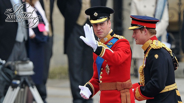 Prince William dressed in the famous red tunic of the Irish Guards wave at the cheering crowd as he and prince Harry walks toward the entrance of Westminster Abbey.