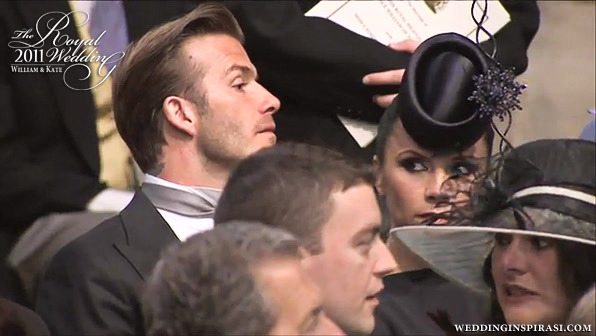 David Beckham and wife Victoria waiting for the arrival of the royal  couple at Westminster Abbey. 6-month pregnant Victoria Beckham wears a  deep navy blue dress from her own Fall 2011 collection, hat by Philip  Treacy and 6-inch high Christian Louboutin heels. David came to the  Abbey wearing his OBE medal on the right lapel of his Ralph Lauren suit  before switching it to the left afterwards. Traditionally, the OBE medal  is worn on the left side.