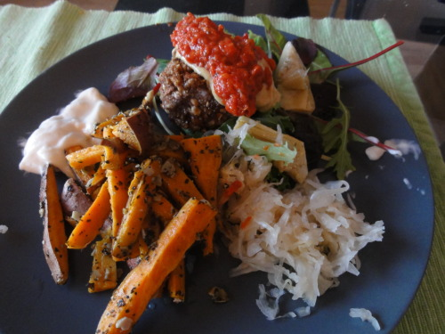 Dinner: Almond rawburger, sweet potatoe fries, homemade raw sundried tomato ketchup and sauerkraut with dijon mustard, vegan mayo, spring greens and artichoke hearts. Eating vegan couldn't be more amazing…