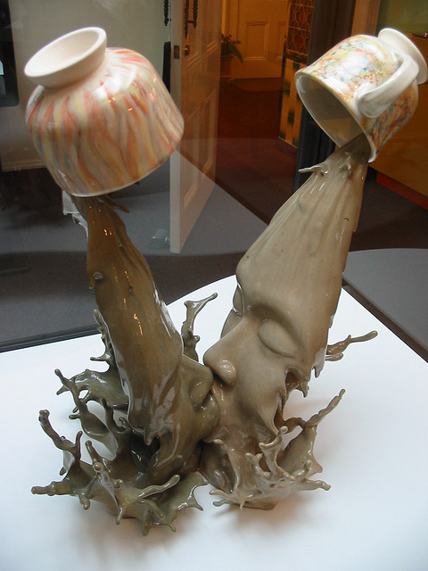 earthlingnumber111billion:  Liquid Kiss      About this piece:  The pottery, named Yuanyang II, is one of the collections of Hong Kong Museum of Art now displaying at the Central Concourse of Hong Kong International Airport (HKIA). It is produced by Tsang Cheung-shing, a ceramic art tutor and product designer. Yuanyang II is modeled in a distinctive form with two figures indulged in kissing each other. Their heads support two elegant cups for drinking tea and coffeeThe form and concept designfully complement the theme Yuanyang (a typical Hong Kong beverage of mixing tea and coffee), a symbol of marriage and love, with a touch of humour for artistic creation.  Source:http://www.neatorama.com/2007/08/17/liquid-kiss-sculpture/