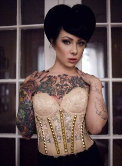 pin-up hair, corset, studs, tattoos, black nail polish, lace, monsters, skulls, foxy lady o.O SO MUCH RIGHT WITH THIS RIGHT NOW!